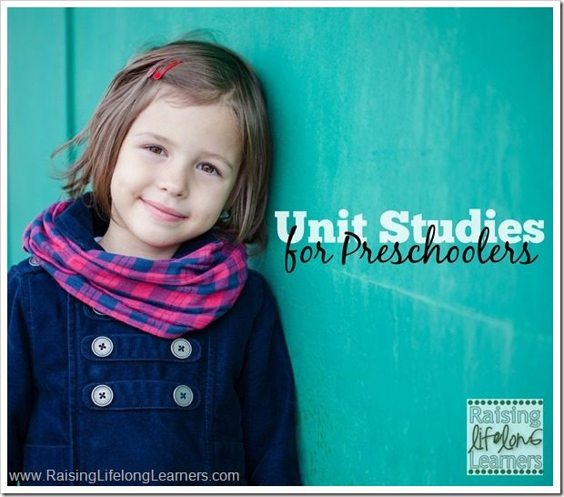 Portrait of preschooler girl near green wall