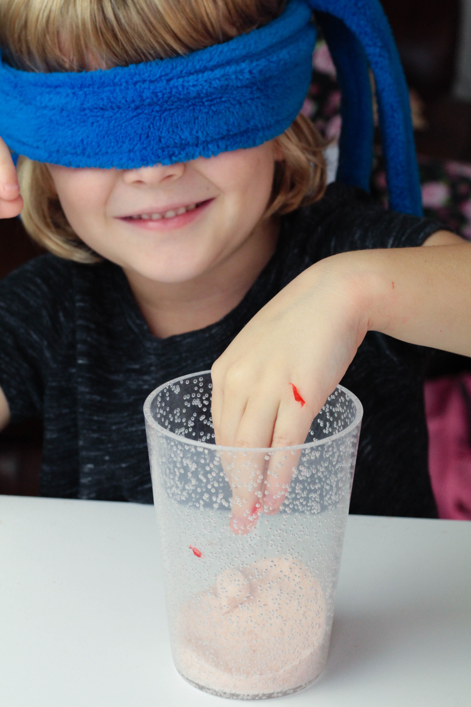 Explore your senses in this sensory blindfold science activity perfect for preschoolers and kindergarten kids. Science has never been so fun!